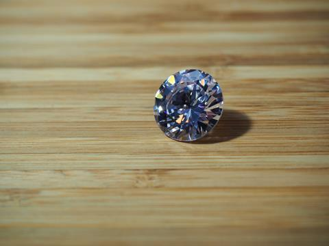Diamond cut colored zirconium crystal