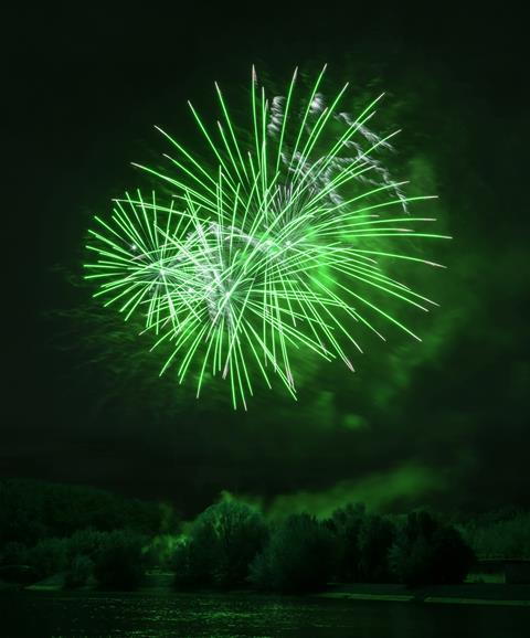 A photograph of green fireworks