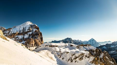 Winter in the italian alps, with the ski slope full of snow