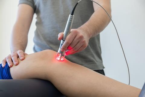 Laser therapy being used to treat knee pain