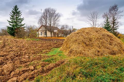 Autumn plowed fields farm house