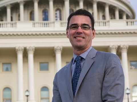 Michael Fernandez in front of the Capitol building in Washington DC, USA