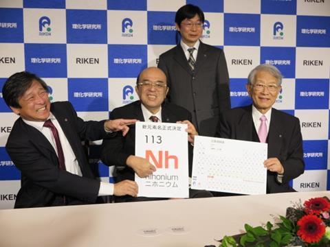 Kōsuke Morita, Kōji Morimoto, Hiroshi Matsumoto, and Hideto En'yo celebrate the naming of Nihonium