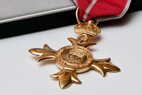 An image of an OBE medal