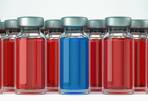 Several ampules containing a red solution and one containing a blue solution