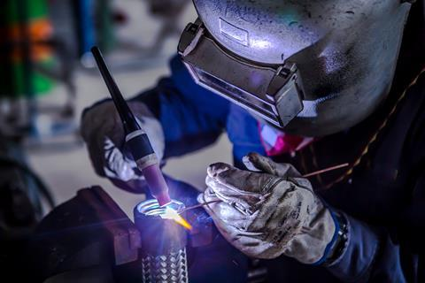 Welder is welding Tungsten Inert Gas welding
