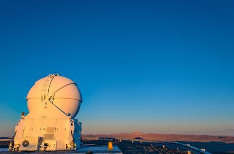 A photograph of an auxiliary telescope in the Atacama desert, Chile