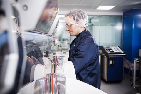 Researcher working in the Cell and Gene Therapy Catapult manufacturing centre