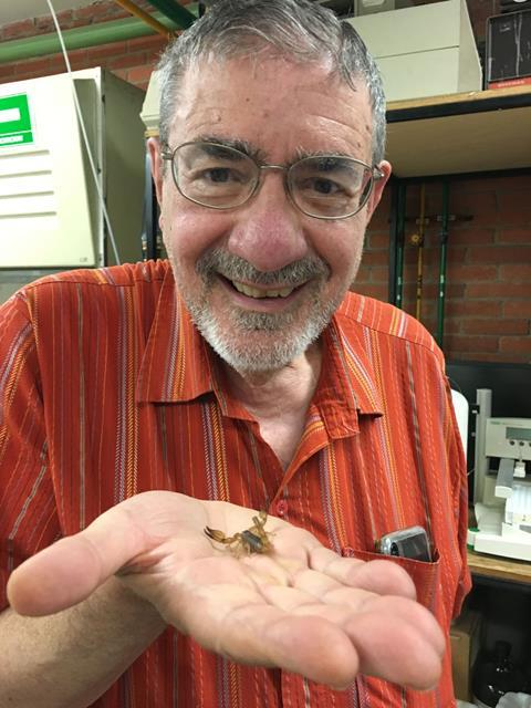 An image showing Professor Richard Zare holding the Mexican scorpion species Diplocentrus melici in his hand