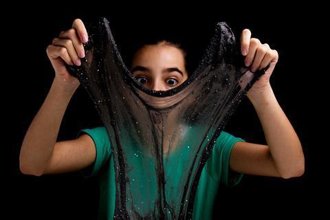 Girl with black glitter slime