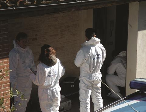 Forensic scientists at the scene of the crime (Meredith Kercher murder)