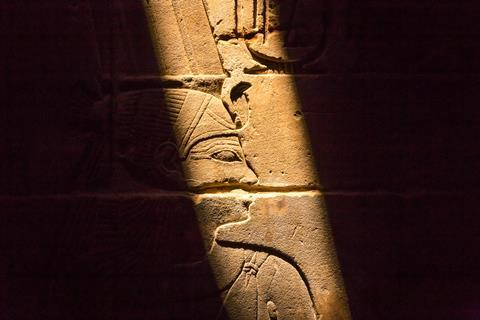 Stone wall with Egyptian carving figures and hieroglyphs, Luxor, Egypt