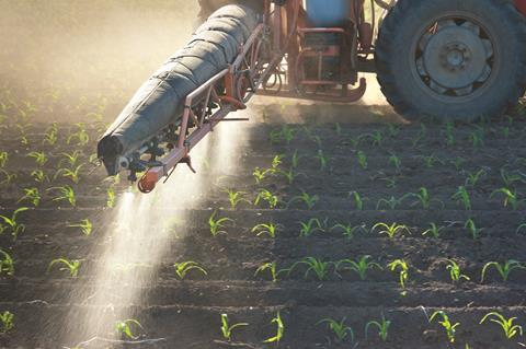 Agricultural crops being sprayed