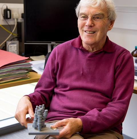 Richard Henderson with a molecular model of bacterial rhodopsin