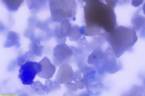 A picture of a magnified lapis lazuli particle