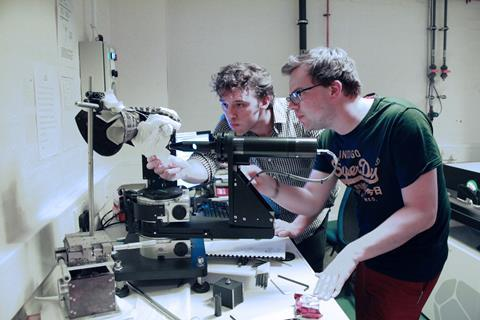 Dr Alex Mellor and Tom Wilson checking the placement of the gauntlet in the ellipsometer