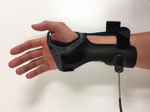 A picture showing a glucose monitoring device from a human forearm