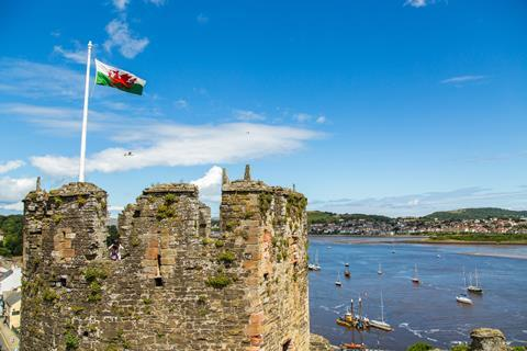 The Red Dragon flies above a Welsh castle