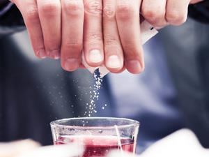 Adding artificial sweetener to a drink