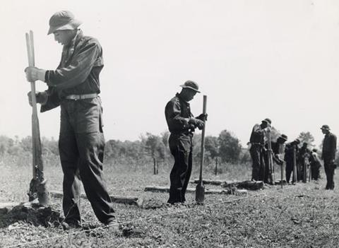 Civilian conservation corps (CCC) putting up a fence