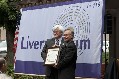 Lawrence Livermore National Laboratory Director Parney Albright (left) accepts a proclamation from Livermore Mayor John Marchand during the naming of 116 S. Livermore Ave. as Livermorium Plaza.
