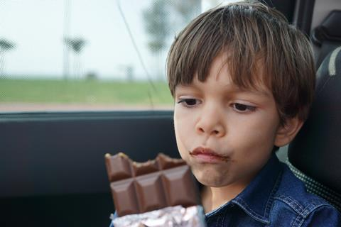 A picture of a child eating chocolate
