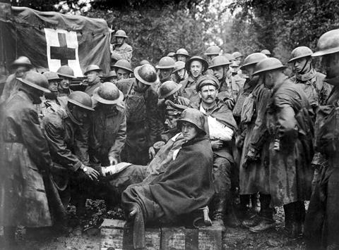 Wounded German prisoners receiving medical attention at first-aid station of 103rd and 104th Ambulance Companies. WWI. Sept. 1918.