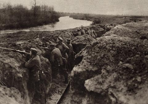 German troops holding a first-line trench on the river bank