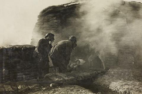 Stretcher bearers with a wounded in a trench during the release of asphyxiating gas, soldiers with gas-masks, World War I, Italy, 20th century.