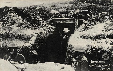 Early 1900's WWI postcard depicting Americans in a front line trench in France with gas masks on.