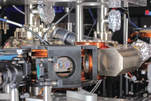 The experimental apparatus and the supporting optical components for the production and manipulation of a quantum gas of polar molecules (KRb)
