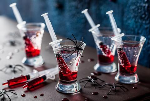 Halloween themed drinks with blood-red Grenadine syrup in syringes