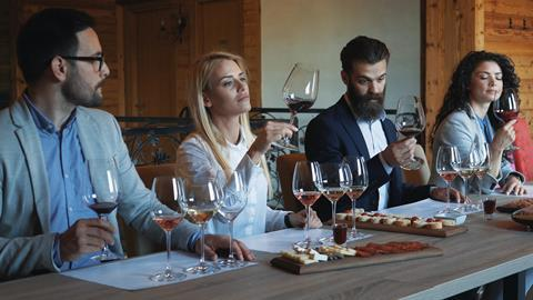 An image showing people tasting wine