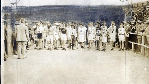 1904 Olympics: Runners lined up at start of Marathon Race, receiving instructions immediately prior to start.