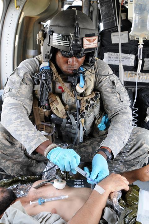 US Army medic in helicopter