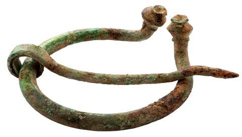 Bronze fibula - a decorative clothing fastener found in bronze age archaeological sites