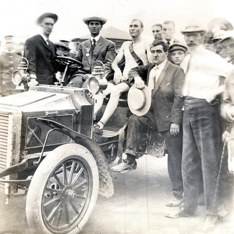 1904 Olympics: Thomas J. Hicks, Boston, winner of the Marathon Race resting in a car after the finish.