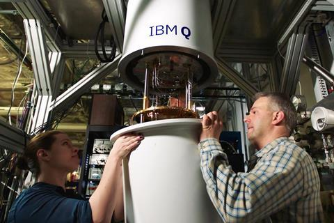 An image showing IBMers Sarah Sheldon and Pat Gumann working on a quantum dilution refrigerator