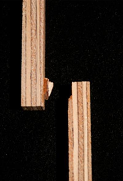 An image showing plywood substrates in which the joint created from a bovine serum albumin adhesive broke one adherend due to high adhesion strength