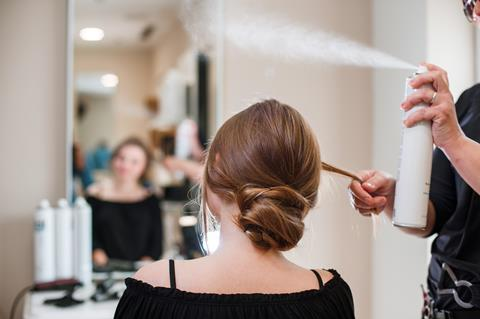Hairstyling process using hairspray in a beauty salon