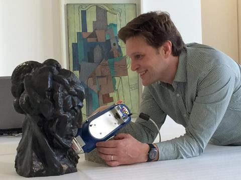 Caption: Marc Walton, co-director of Northwestern University/Art Institute of Chicago Center for Scientific Studies in the Arts (NU-ACCESS), uses portable equipment for elemental analysis of the alloy of Pablo Picasso, Tête de femme (Fernande), Paris, aut