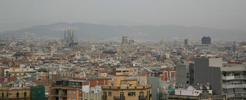 An image showing the skyline of polluted Barcelona