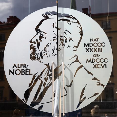 Portrait of Alfred Nobel on the glass door of Swedish Academy and Nobel Museum in Stockholm