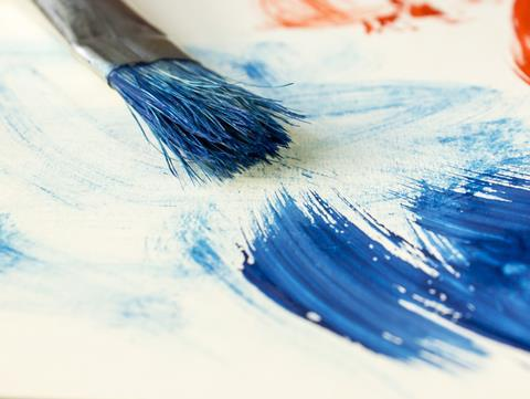 Brush on white paper with red and blue paint