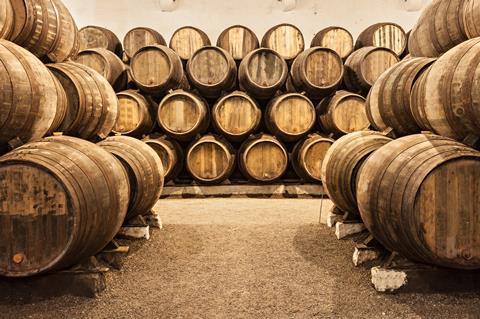 Barrels in a wine cellar in Porto