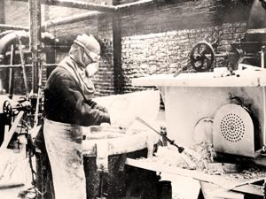 Old photo of a man making guncotton
