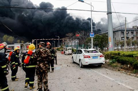 An image showing firemen and Chinese paramilitary police officers at an explosion site in Yancheng