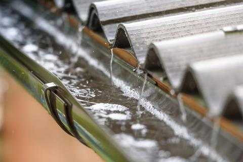 An image showing rain flowing from a roof
