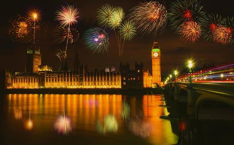 A photograph of a fireworks display over Westminster Palace