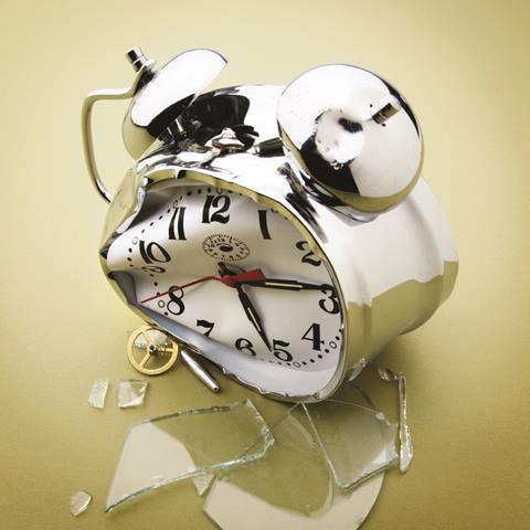Broken alarm clock with smashed glass